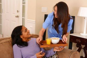 34937666 - home health care worker and an adult woman