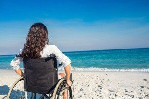 42580798 - disabled woman looking at the ocean on a sunny day